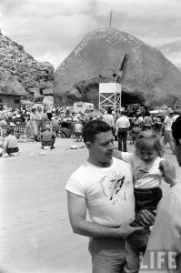 Shirt vendor and child at 1950s UFO convention