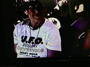 Video capture of a woman wearing a UFO convention t-shirt in the 1970s